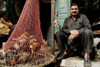 Lahore, Punjab, Pakistan: chicken in a net - poultry seller in the Old City - photo by G.Koelman