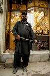 Lahore, Punjab, Pakistan: security guard armed with a shotgun in front of a jeweler - gold - photo by G.Koelman