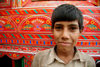 Peshawar, NWFP, Pakistan: portrait of a boy in front of a decorated truck - photo by G.Koelman