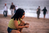 Karachi, Sindh, Pakistan: something catches the eye - s girl looking out towards the Arabian sea - photo by R.Zafar