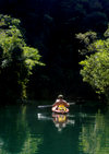 Rock Islands / Chelbacheb, Koror state, Palau: sea kayaker paddling- photo by B.Cain