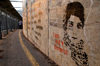 Bethlehem, West Bank, Palestine: graffitti on wall outside checkpoint - Palestinian woman's face and caption 'I am not a terrorist' - photo by J.Pemberton
