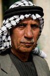 Hebron, West Bank, Palestine: portrait of local man wearing a keffiyeh scarf - photo by J.Pemberton