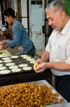 Hebron, West Bank, Palestine: local food vendor preparing sweets - photo by J.Pemberton