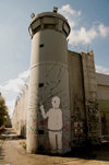 near Bethlehem, , West Bank, Palestine: graffitti on watchtower - breaking the wall with a single finger - hafrada fence - photo by J.Pemberton