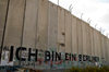near Bethlehem, West Bank, Palestine: graffitti on Wall - Kennedy's 'Ich bin ein Berliner' - which can mean 'I am a doughnut' - concrete slabs of the separation fence - photo by J.Pemberton