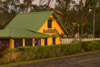 Panama - Cerro Azul: yellow house with green roof bathed in golden light - photo by H.Olarte