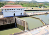 Panama Canal: Miraflores locks - notice the huge difference in levels between locks - hydraulically operated miter gates - Esclusas de Miraflores - each lock is 110 feet wide by 1000 feet long - photo by M.Torres