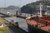 Panama Canal: Miraflores locks - locomotives towing a Panamax vessel - photo by H.Olarte