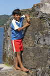 Local kid poses for the camera at Fuerte de San Jeronimo, Portobello, Col�n, Panama, Central America - photo by H.Olarte