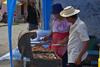 A man and a woman grill some meat for vending - Portobello, Colón, Panama - photo by H.Olarte