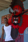 A congo culture man shows a devil mask, which represents the 'oppresor' white Spanish man, during the bi annual meeting of Devils and Congos, Portobello, Colón, Panama, Central America - photo by H.Olarte