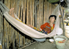 Panama - comarca Kuna Yala - San Blas Islands: Kuna woman in an hammock - photo by A.Walkinshaw