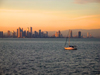 Panama City: seen from the Pacific Ocean - sailboat with skyline as background - photo by H.Olarte