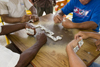 Anton, Cocle province, Panama: four men playing dominoes - table view - photo by H.Olarte
