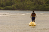 Isla Grande, Colon province, Panama: lone man with a kayak - photo by H.Olarte