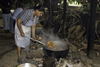 La Villa, Azuero, Los Santos province, Panama: cooking over an open fire and picking chicken with a huge spoon at El Ciruelo folk food place, - photo by H.Olarte