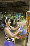 Azuero, Los Santos province, Panama: s woman cuts pieces of pork chorizo sante�o for sale at the side of the road that goes from Chitr� to Divisa - photo by H.Olarte