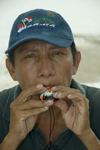 Panama - Panama City: man blowing trinket whistle in the old town - photo by D.Smith