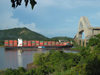 Panama Canal: Panamax Container Ship passing under Puente de las Americas - Americas Bridge - photo by H.Olarte