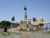 Trujillo, La Libertad region, Peru: freedom monument on Plaza de Armas - sculpture by Edmundo Moeller - Cathedral on the right and Hotel Libertador on the left - the city is named after Francisco Pizarro's native town in Spanish Extremadura - photo by D.Smith
