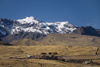 Puno region, Peru: hills with snow - the Andes and the high Altiplano as seen from the train from Puno to Cusco - photo by C.Lovell