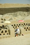 Chan Chan, Trujillo, La Libertad region, Peru: Palacio Tschudi - archeologists at work using parasols in the Chan Chan archaeological site - Moche / Chimu civilization - UNESCO World Heritage site - photo by D.Smith