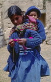 Cuzco region, Peru: Quechua woman with baby � Inca descendents - photo by C.Lovell