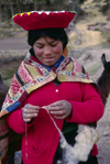 Cuzco region, Peru: young Quechua woman spinning wool - Peruvian Andes - photo by C.Lovell