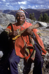 Cuzco region, Peru: old Quechua man playing guitar - Peruvian Andes - photo by C.Lovell