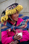 Ausangate massif, Cuzco region, Peru: Quechua woman drinks the local brew in a rural town - Chicha de jora, a fermented beverage derived from maize - photo by C.Lovell