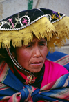 Ausangate massif, Cuzco region, Peru: Quechua woman wearing traditional hat - photo by C.Lovell