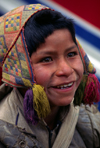 Ausangate massif, Cuzco region, Peru: smiling boy in a rural town – Quechua people - photo by C.Lovell