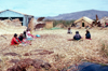 Lake Titicaca - Puno region, Peru: village life - Uro indians village - floating rafts made of totora reeds - photo by J.Fekete