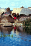 Lake Titicaca - Puno region, Peru: Uros girl on a floating islet - indigenous village - photo by J.Fekete