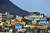 Lima, Peru: colorful shanty town under Cerro San Crist�bal - photo by M.Torres