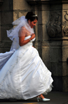 Lima, Peru: a bride rushes to her wedding - Archbishop's palace in the background - Plaza de Armas - photo by M.Torres