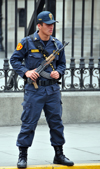 Lima, Peru: policeman with AK-47 Kalshnikov rifle guards the Government Palace - Plaza de Armas - photo by M.Torres