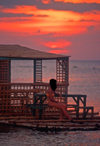 Philippines - Beach - sunset - girl relaxing - benches - photo by B.Henry