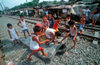 Manila city, Philippines - children play with an old matress - Slums and shanty towns - photo by B.Henry