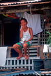 Manila city, Philippines - happy boy with Jesus icon - Slums and shanty towns - photo by B.Henry