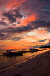 Alona Beach, Bohol island, Central Visayas, Philippines: bancas at sunset - beach scene - photo by S.Egeberg