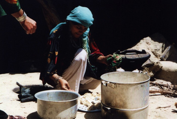 afghanistan1: Afghanistan: Woman cooking outdoors - photo by Anne Dinnan - (c) Travel-Images.com - Stock Photography agency - the Global Image Bank