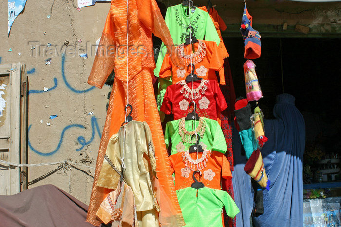 afghanistan29: Afghanistan - Herat province - shop with girls' clothes with two women in burkas shopping - photo by E.Andersen - (c) Travel-Images.com - Stock Photography agency - Image Bank