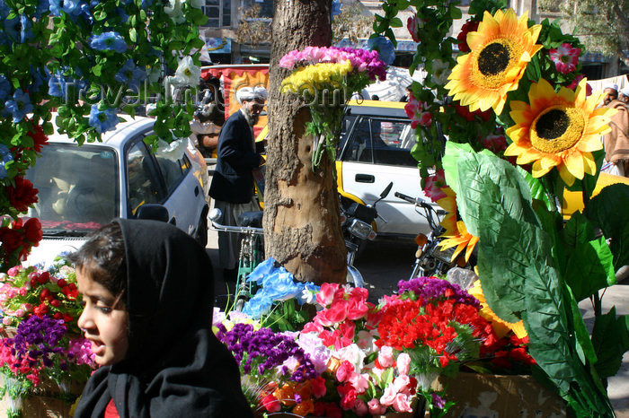 afghanistan8: Afghanistan - Herat - girl passing a shop selling artificial flowers - photo by E.Andersen - (c) Travel-Images.com - Stock Photography agency - Image Bank