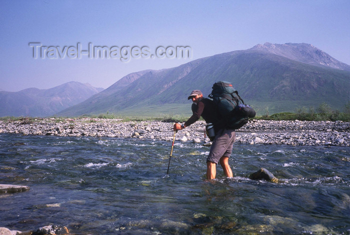 alaska142: Brooks range, Alaska: crossing a river during the South-North Alaska expedition - photo by E.Petitalot - (c) Travel-Images.com - Stock Photography agency - Image Bank
