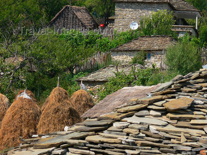 albania164: Kamnik, Kolonjë, Korçë county, Albania: schist roof and haystacks - rural scene - photo by J.Kaman - (c) Travel-Images.com - Stock Photography agency - Image Bank