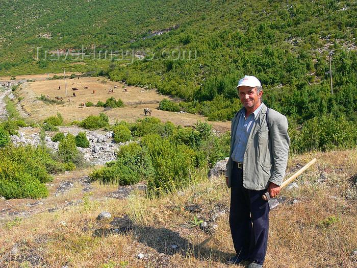 albania165: Kamnik, Kolonjë, Korçë county, Albania: man with axe - photo by J.Kaman - (c) Travel-Images.com - Stock Photography agency - Image Bank