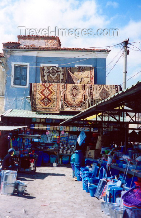 albania24: Albania / Shqiperia - Korçë / Korça / Korce: selling carpets and rugs - bazaar scene - photo by M.Torres - (c) Travel-Images.com - Stock Photography agency - Image Bank