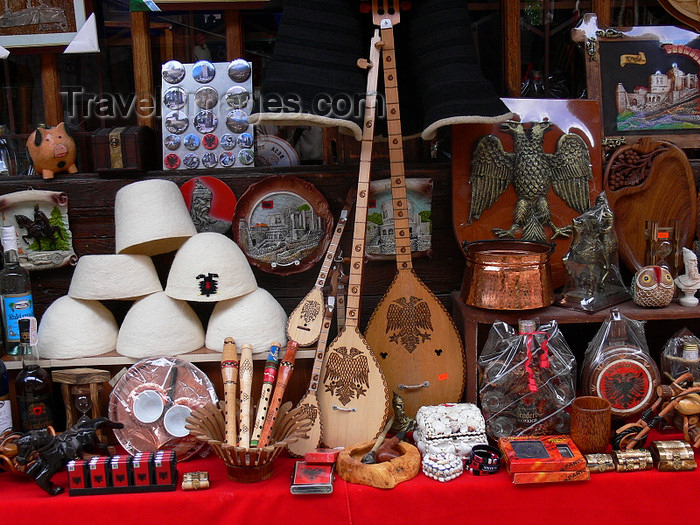 albania87: Kruje, Durres County, Albania: Albanian kitsch - qeleshe caps, eagles, flutes... - local market - photo by J.Kaman - (c) Travel-Images.com - Stock Photography agency - Image Bank